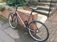 Adult bicycle for sale £50. needs servicing. Come and checkout before buying.
