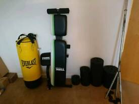 Weight bench, barbell, dumbells, punching bag