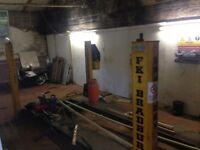 Bradbury 4 post lift with jacking beam