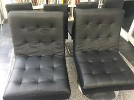 X2 leather swivel chairs