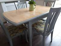 Extending dining table with 4 chairs. Compact