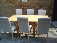 Extending pine table and 6 cream highback chairs all in great condition
