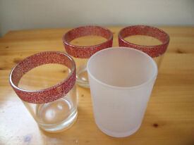 4 (1 white frosted glass, 3 clear glass + red sparkle rim) tea light/small candle holders. £1 lot.