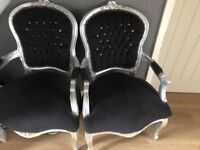 Two black and silver chairs
