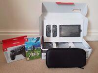 Nintendo Switch + Zelda: Breath of the Wild + Nintendo Pro Controller + Nintendo Carry Case