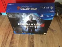 PS4 with unchartered 4 & FIFA 17 new. 500gb slim
