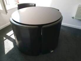 Black space saver table and chairs