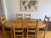 REDUCED, need gone ASAP. Open to offers. Extendable dining room table and chairs.