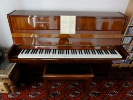 Petrof upright piano and matching stool