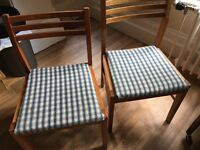 Two upholstered kitchen chairs.