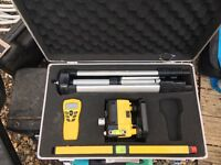 laser level in case with accessories