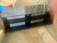 Black glass top tv stand with brown wooden sides