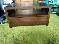 Dark wood TV stand