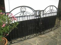 Two matching wrought iron gates for driveway - strong and solid with characterful scrollwork