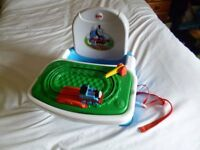 Booster seat for eating at the table by Fisher Price with take off Thomas tray