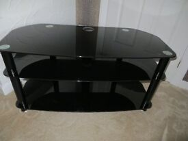 Dark Glass Television Table.
