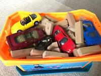 Wooden bricks and about 20 toy cars