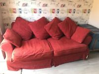 Large sofa with spare covers