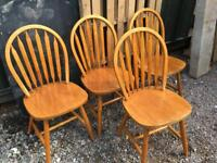Four solid wooden chairs