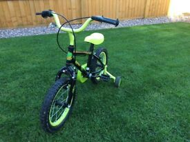 "Child's Apollo Claws 14"" bike with stabilisers."