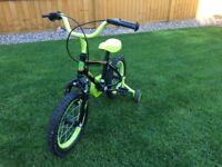 """Child's Apollo Claws 14"""" bike with stabilisers."""