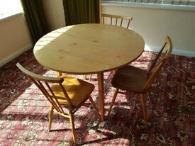 Table and three chairs
