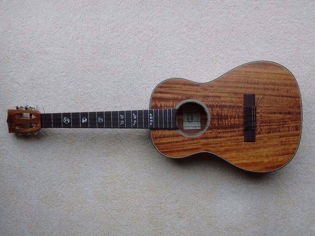 Kala Baritone ukulele, all solid acacia ASAC-B, slotted headstock. Case and spare strings included.