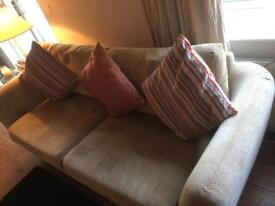 Two Seater Sofa with cushions in good condition