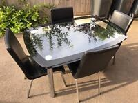 Black glass dining room table and 4 chairs