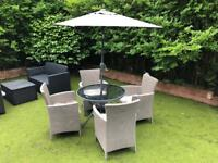 Brand New. Cost £400 4 Seater Outdoor Garden Dining Table + 4 Alliber Iowa Chairs