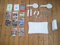 Wii + Wii fit + games