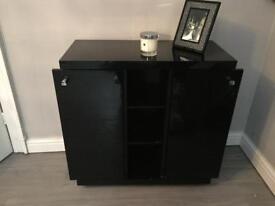 Black gloss media storage unit