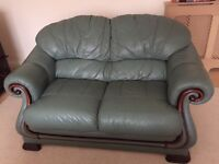 2 x two-seater leather sofas, green.