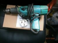 Electric hand drill.