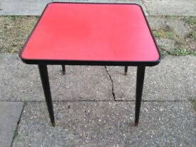 Red Formica top occasional table,very retro.