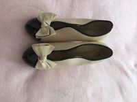 cream/navy heeled shoes….
