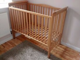 Wooden baby cot with sliding side