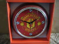 """""""MANCHESTER UNITED"""" Quartz clock. New and supplied with battery."""