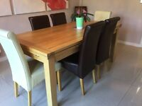 2 brown leather dining chairs