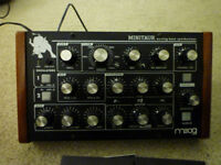 moog minitaur bass synth and manual power suppy and wooden checks ends