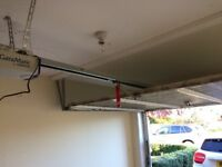 Garage door - white, automated with remote.
