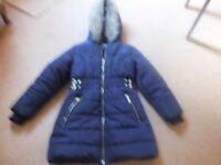 GIRL'S NAVY BLUE QUILTED COAT. 7-8 YEARS.