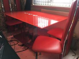 RED GLASS TABLE AND SIX HIGH BACK CHAIRS