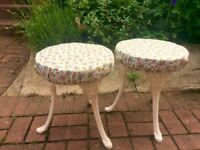 Pair of upcycled white and cream vintage dresser stools with cast iron legs and floral upholstery.
