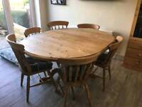 Extenable solid oak table and six chairs.