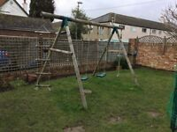 Plum Gibbon Wooden Garden Swing Set including 2 swings, a rope ladder and a climbing rope
