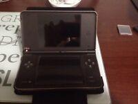 Nintendo DSi XL plus case and games.