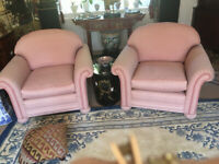 Pair of pink upholstered armchairs