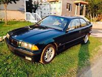 BMW 328 is 1998 coupe 125400 kms