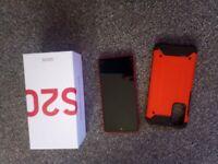 Samsunf s20 fe. In red smartphone mobile phone